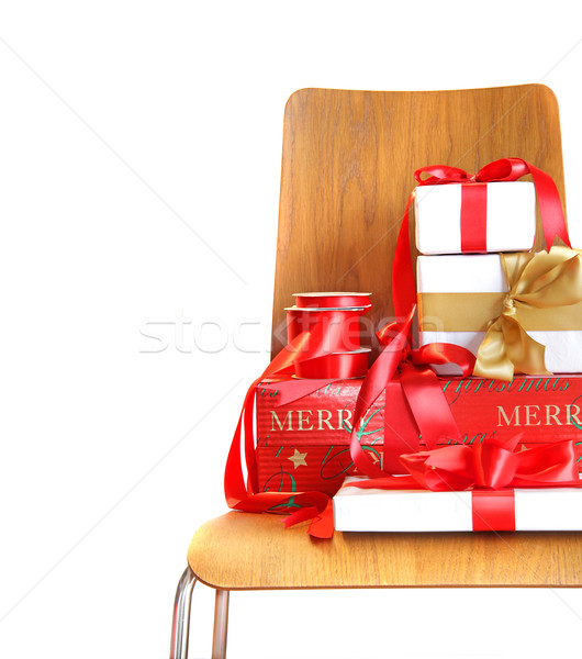 Pile of gifts on wooden chair against white Stock photo © Sandralise
