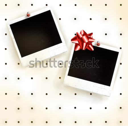 White peg board with photo frames Stock photo © Sandralise