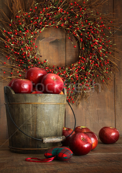 Wood bucket of apples for the holidays Stock photo © Sandralise