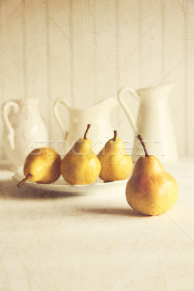 Fresh pears on old wooden table with vintage feeling Stock photo © Sandralise