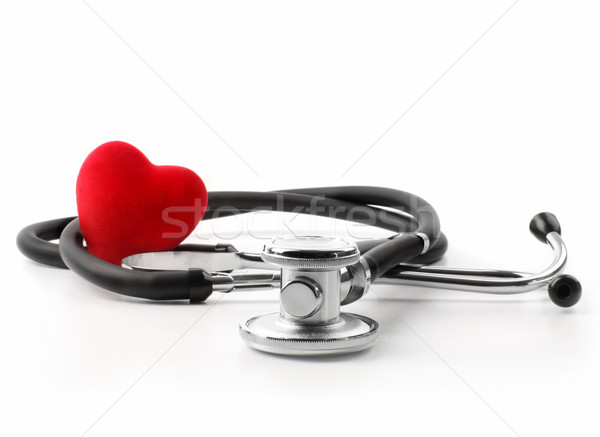 Stethoscope with heart on a white Stock photo © Sandralise