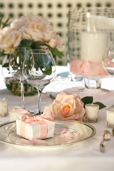 Small gift on plate at wedding reception Stock photo © Sandralise