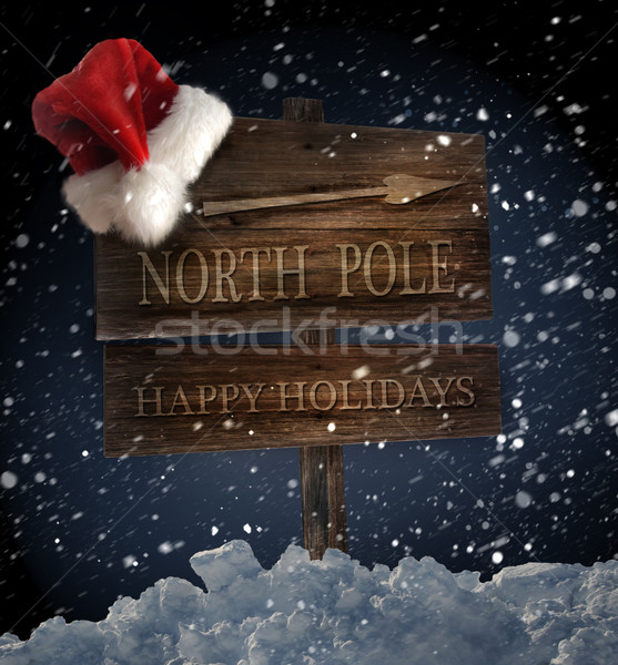 Wooden sign with santa hat on snowy background Stock photo © Sandralise