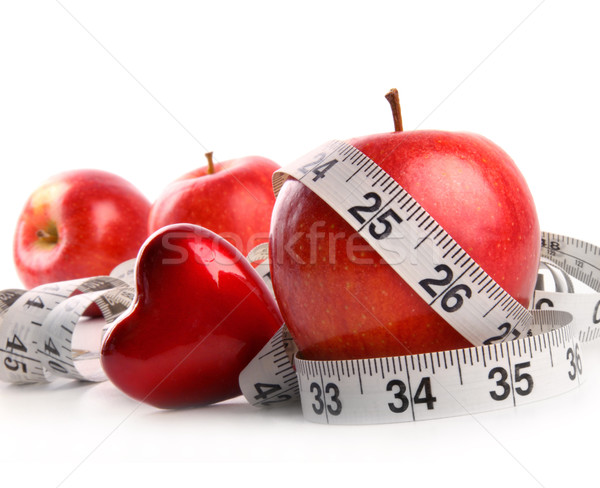 Red apples,heart and measuring tape on white  Stock photo © Sandralise