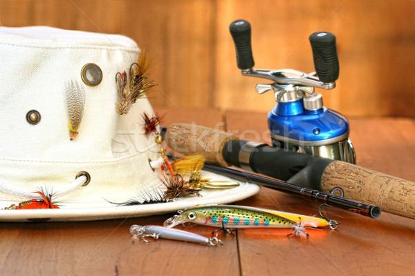 Fishing reel with hat and color lures Stock photo © Sandralise