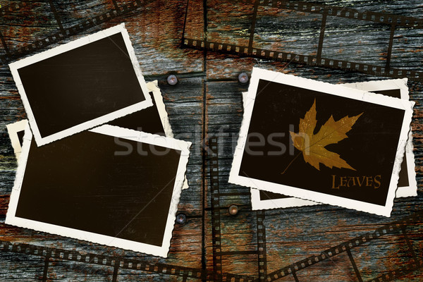 Old photos and film on rustic barn wood Stock photo © Sandralise