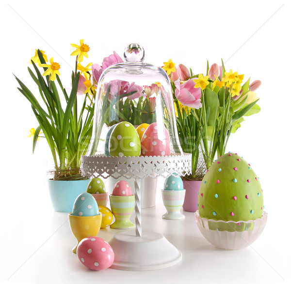 Easter eggs on cake stand with spring flowers  Stock photo © Sandralise