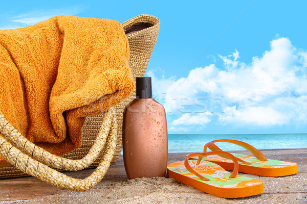 Bronzage lotion serviette plage ciel Photo stock © Sandralise