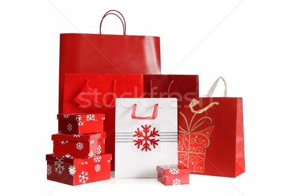 Stock photo: Various sizes of holiday shopping bags and gift boxes on white