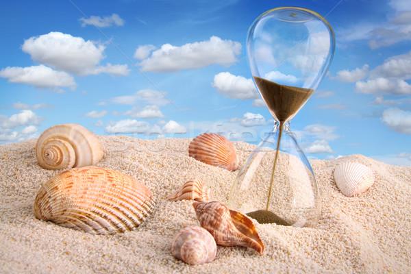 Zandloper zand blauwe hemel business water geld Stockfoto © Sandralise