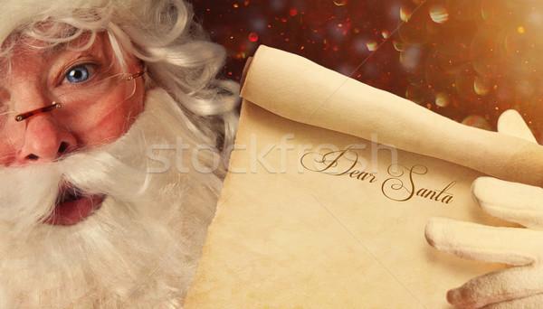 Closeup of Santa holding a Dear Santa scroll  Stock photo © Sandralise