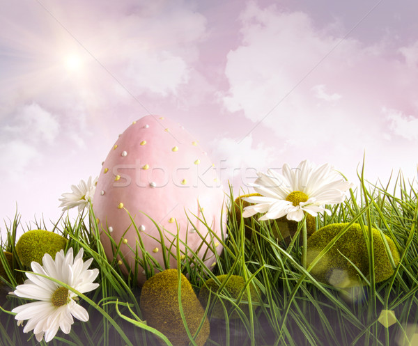Large pink easter with flowers in tall grass Stock photo © Sandralise