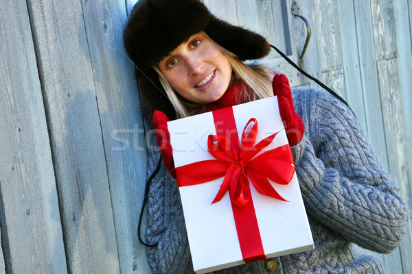 Girl holding Christmas gift Stock photo © Sandralise