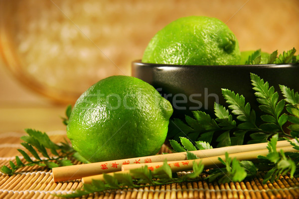 Limes with chopsticks Stock photo © Sandralise