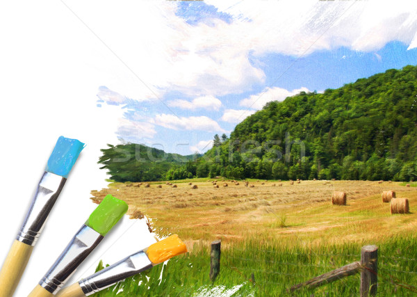 Artist brushes with a half finished painted rural landscape Stock photo © Sandralise