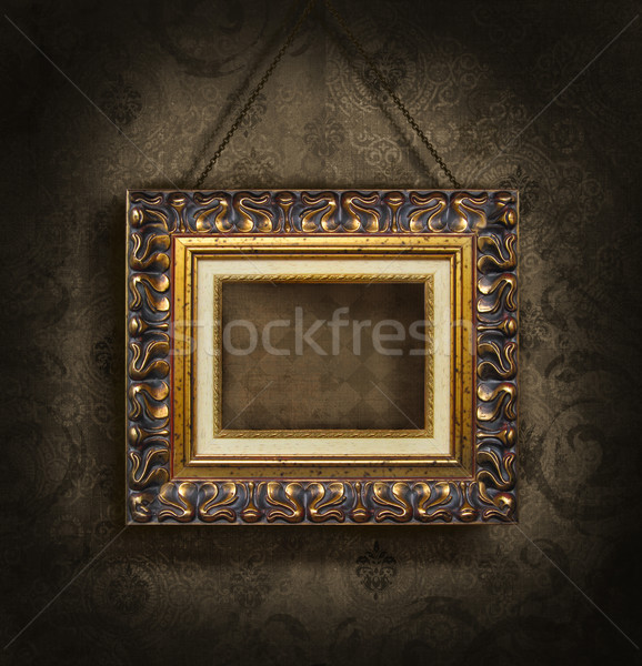 Stock photo: Gold picture frame on antique wallpaper