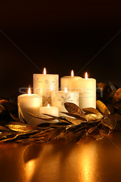 White candles with gold leaf garland  Stock photo © Sandralise