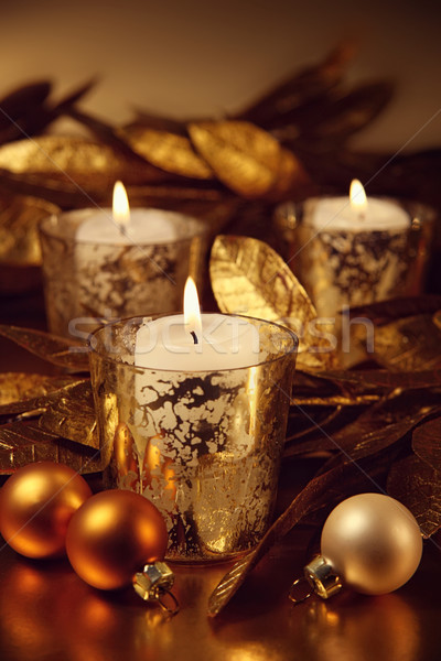 Closeup of candles lit with a sparkling gold theme Stock photo © Sandralise