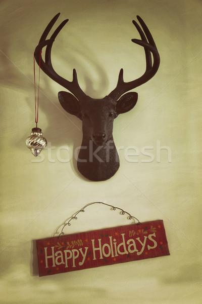 Closeup of mounted deer head with christmas ornament and holiday Stock photo © Sandralise