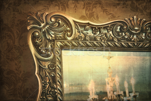 Gilded mirror reflection of chandelier Stock photo © Sandralise