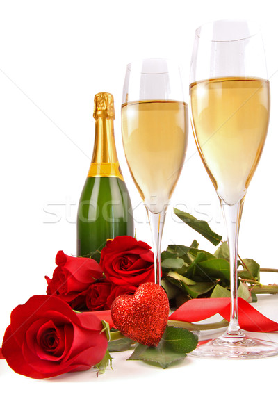 Champagne glasses with red roses and little heart Stock photo © Sandralise