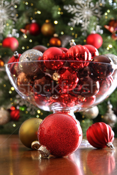 Christmas ornaments on table in front of tree Stock photo © Sandralise