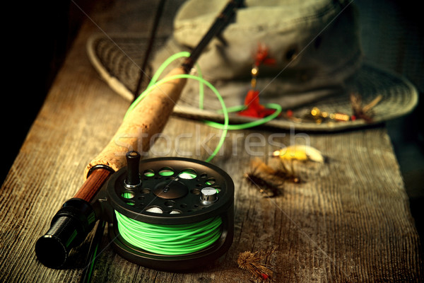 Fly fishing equipment with old hat on bench Stock photo © Sandralise