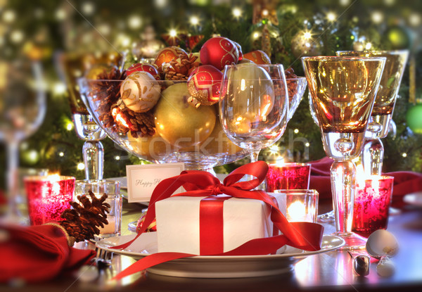 Holiday table setting with red ribboned gift Stock photo © Sandralise
