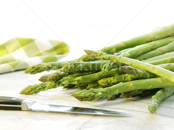 Freshly picked asparagus on white marble Stock photo © Sandralise