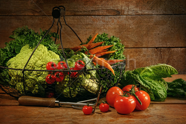 Freshly picked vegetables in basket on wooden table Stock photo © Sandralise