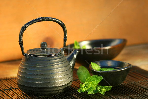 Japanese teapot and cup with mint tea  Stock photo © Sandralise