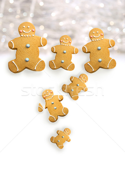 Gingerbread men cookies against sparkly white  Stock photo © Sandralise
