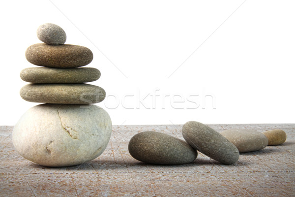Stock photo: Stack of spa rocks on wood on white