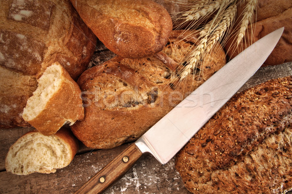 Stock photo: A selection of bread loaves with knife