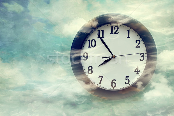 Wall clock on surreal background Stock photo © Sandralise