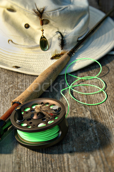 Close-up of fly-fishing reel and rod with hat Stock photo © Sandralise