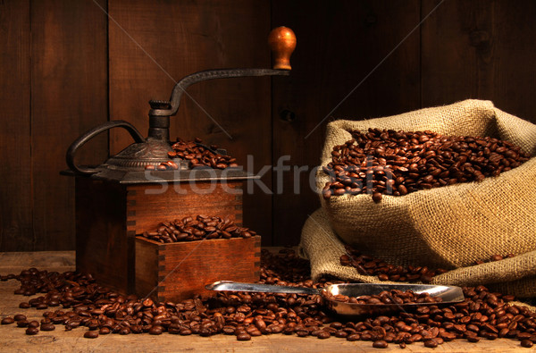Antique coffee grinder with beans Stock photo © Sandralise
