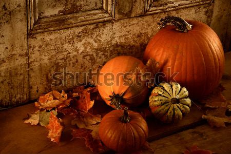 Different sized pumpkins in window Stock photo © Sandralise