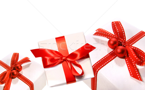 Gifts wrapped with red ribbons isolated on white Stock photo © Sandralise