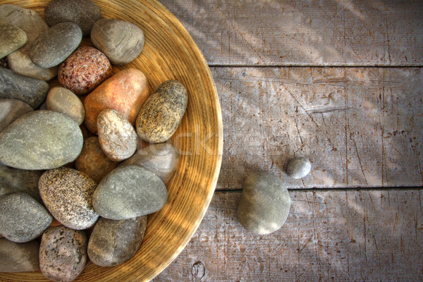 Spa rocks in wooden bowl on rustic wood Stock photo © Sandralise