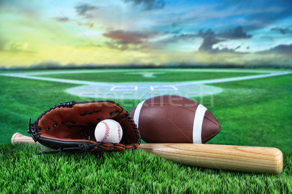 Baseball, bat, and mitt in field at sunset Stock photo © Sandralise