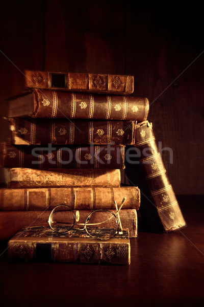 Stack of old books with reading glasses  Stock photo © Sandralise