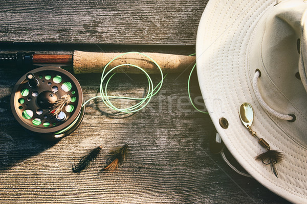 Fly fishing rod with hat on wood Stock photo © Sandralise