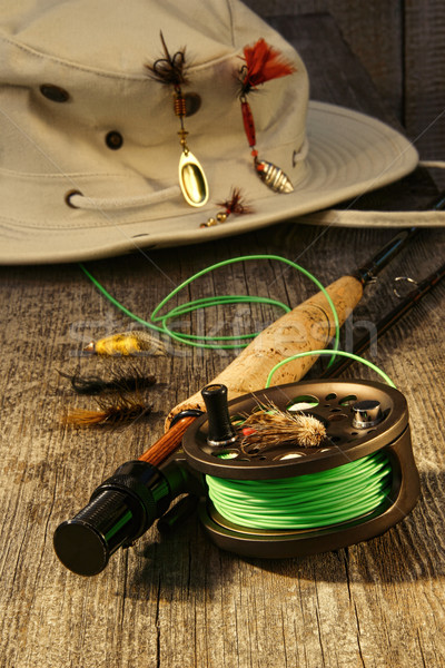 Fishing reel and hat on bench Stock photo © Sandralise