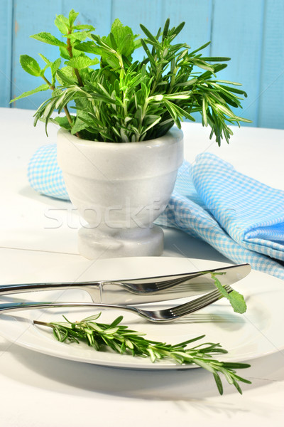 Stock photo: Fresh green herbs on a table