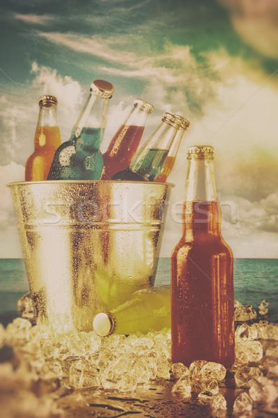 Summer drinks in ice bucket on the beach Stock photo © Sandralise