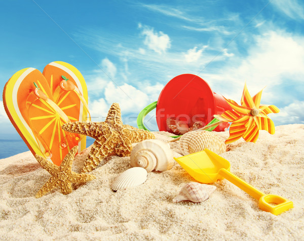 Child's beach toys in the sand Stock photo © Sandralise
