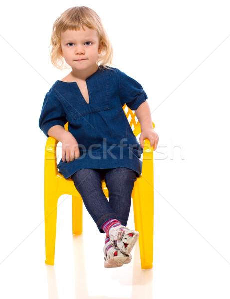 Küçük kız oturma sandalye yalıtılmış beyaz kız Stok fotoğraf © sapegina