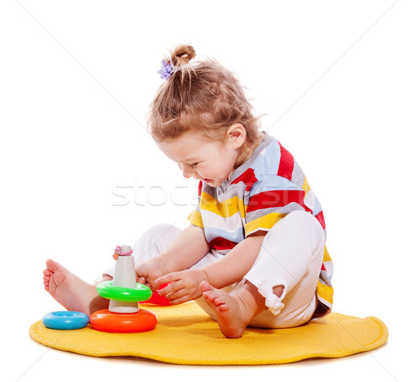 Kız oynama bebek piramit yalıtılmış Stok fotoğraf © sapegina