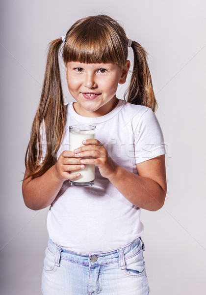 Girl loves milk Stock photo © sapegina